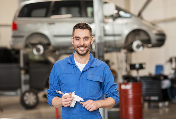 car mechanic holding a wrench
