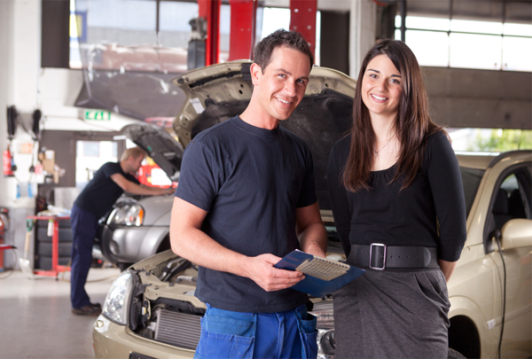 car mechanic with happy customer